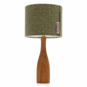 Oak bottle bedside table lamp with Green Harris tweed shade